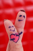 Lovers fingers on red background — Stock Photo