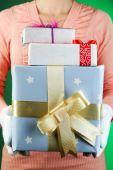 Gift box in female hand — Stock Photo
