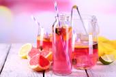 Pink lemonade on table on bright background close-up — Stock Photo