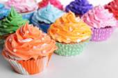 Delicious cupcakes on white background — Стоковое фото