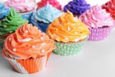 Delicious cupcakes on white background — ストック写真