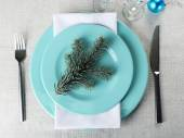 Stylish blue and white Christmas table setting on grey tablecloth background — ストック写真