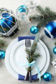 Stylish blue and white Christmas table setting on grey tablecloth background — Stock Photo