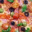 Tasty pizza with sausage and vegetables, macro view — Stock Photo #61369983