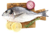 Fresh raw fish on cutting board and food ingredients isolated on white — Stock Photo