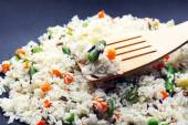 Tasty rice preparing in wok, close-up — ストック写真