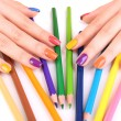 Multicolor female manicure with colored pencils isolated on white — Stock Photo #61370163