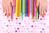 Multicolor female manicure with markers and pencils on bright background — Foto de Stock