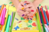 Multicolor female manicure with stationery on bright background — Foto de Stock
