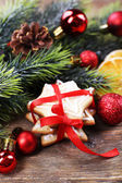 Gingerbread cookies with Christmas decoration on wooden table background — ストック写真