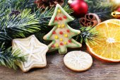 Gingerbread cookies with Christmas decoration on wooden table background — Stockfoto