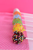 Sweet cake pops on table on pink background — Stock Photo