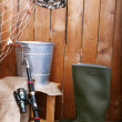 Fishing equipment on wooden wall background, indoors — Stock Photo #61489769