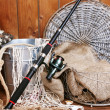Fishing equipment on wooden wall background, indoors — Stock Photo #61489813