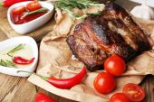 Delicious grilled meat on table — Stock Photo