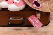 Suitcase and tourist stuff with inscription travel insurance on wooden background — Stock Photo