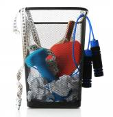 Metal trash bin with sport equipment, crumpled paper and weight scale isolated on white — Stockfoto