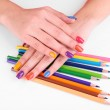 Multicolor female manicure with colored pencils isolated on white — Stock Photo #61490183