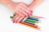 Multicolor female manicure with colored pencils isolated on white — Stok fotoğraf