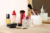 Cosmetics on dressing table — Stock Photo