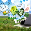 Laptop and images of nature on field and sky background — Zdjęcie stockowe #61522551