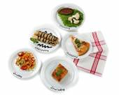 Daily menu. Plates with food on table — Stock Photo