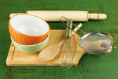 Kitchen utensils for baking on color wooden background — Stock Photo