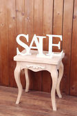 Sale on side table in room — Stock Photo