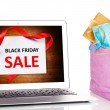 Laptop and bags with gifts isolated on white, Black Friday Sale concept — Stock Photo #61652619