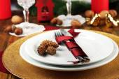Holiday table setting with Christmas decoration background — Stock Photo