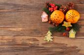 Orange with cookies, spices and sprigs of Christmas tree on rustic wooden background — Stock Photo