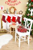 Beautiful Christmas interior with sofa, decorative fireplace and fir tree — Photo
