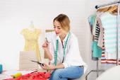 Beautiful young dressmaker in workroom — Stockfoto