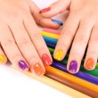 Multicolor female manicure with colored pencils isolated on white — Stock Photo #61764635