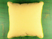 Colorful pillow on textured green wooden background — Stock Photo