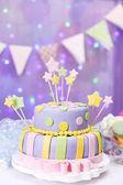 Delicious birthday cake on shiny purple background — Stock Photo