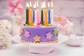 Delicious birthday cake on table on light background — Stock Photo