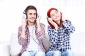 Couple listen to music at home  — Stock Photo