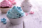 Delicious cupcakes on table close-up — Stock Photo