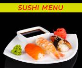 Delicious sushi served on plate isolated on black with space for your text — Stock Photo