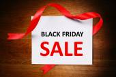 Card with Black Friday Sale text on wooden background — Stock Photo