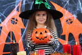 Little girl Witch in hat on Halloween — Stock Photo