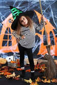 Little girl Witch in hat with broom — Stock Photo