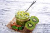 Delicious kiwi jam on table close-up — Stock Photo