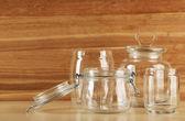 Set of empty glassware on wooden background — Stock Photo
