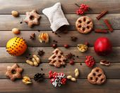 Cookies with fruits and spices on wooden background — Stock Photo
