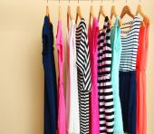 Female dresses on hangers — Stock Photo