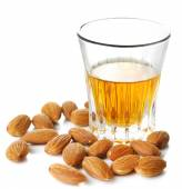 Dessert liqueur Amaretto with almond nuts, isolated on white — Stock Photo