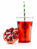 Pomegranate juice in fast food closed cup with tube and garnet isolated on white — Stock Photo