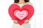Girl with Valentine card — Stockfoto